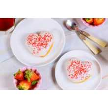 Edible pink Heart shape sprinkles for cake and Desserts decoration available...
